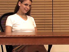 Brunette teen in glasses uses dildo on table