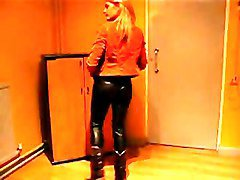blonde girl in tight leather look pants