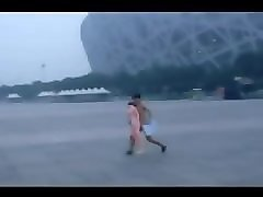 chinese boy naked run in front of birdnest beijing.